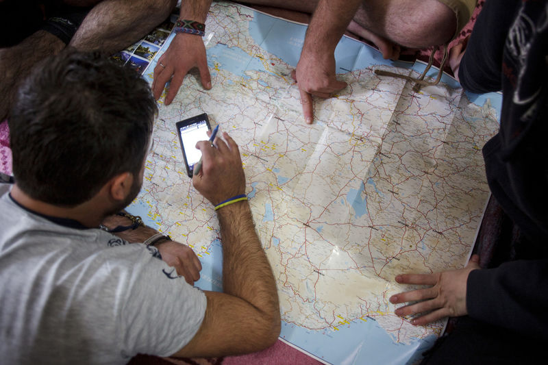 MAP: A gang of four people were known in Istanbul in Turkey. They look at the map to add the route for onward journey.