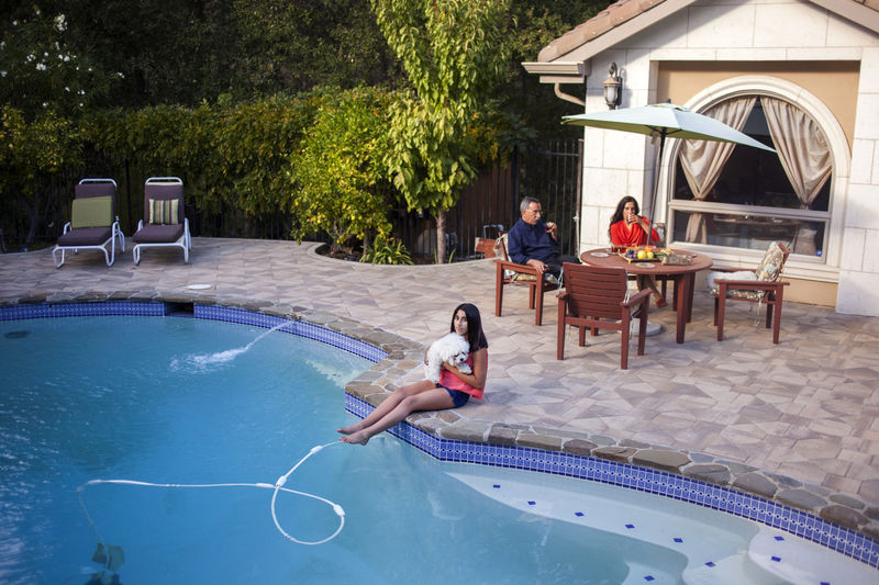 Faz Poursohi and his wife, Fariba, enjoy a day by their swimming pool, with their daughter Bahar. They live in Danville, Calif. Mr. Poursohi is a chef and the owner of four restaurants in the San Francisco Bay Area. He has been in the United States since 1974.