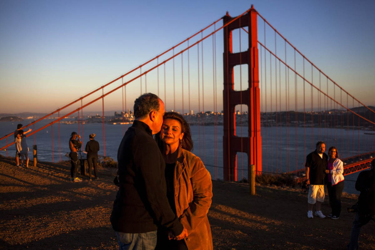 Banafsheh Akhlaghi, an Iranian-American lawyer, with her husband, James Almerico, at the Golden Gate Bridge.