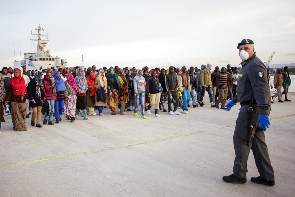 Hundreds of African migrants await registration in the Italian port of Augusta in Sicily.