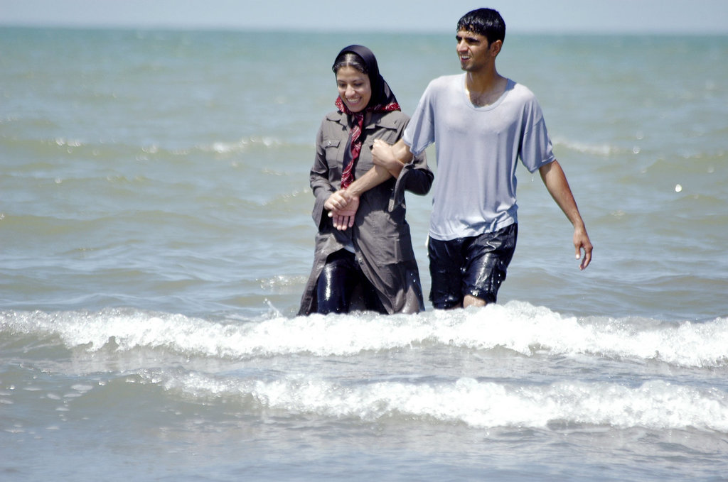 Coast of the Caspian Sea. Iranianc women cannot swim in the sea with men without wearing the prerequisite the hijab covering. They need to be clothed on the beach as well.