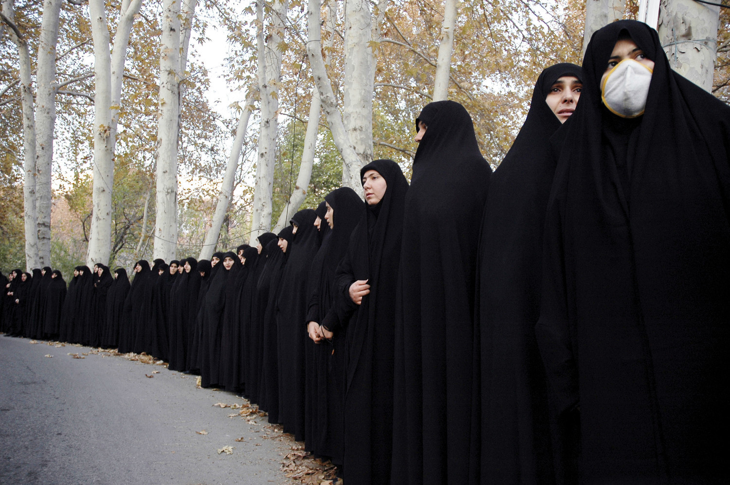 Tehran - Saadabad Palace - Every year many corpses of the war dead from the eight year Iran -Iraq War are found.  Basiji militia-women participate in funeral ceremonies for the Iran Iraq War dead.