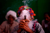 An Indian villager smokes a pipe in New Delhi.