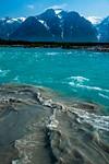 Turquoise Melt Creek meets the coffee-colored Tatshenshini River, British Columbia