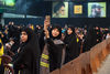 A Hezbollah supporter records the speech of the party's Secretary General, Hassan Nasrallah, during a televised address at a rally marking the party's Martyrs' Day in Dahieh, southern Beirut.