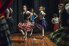 Dancers from Bold Steps dance school perform a Scottish highland dance during a multicultural potluck event at Bowmore Road Junior and Senior Public School, Toronto, November 20, 2014.