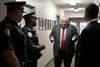 Rob Ford explains himself to the police after he and his brother, councilor Doug Ford, got into a shouting match with organizers of the Mayoral Debate at Presteign-Woodbine United Church, East York, July 28, 2014, Toronto.