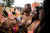 Masqueraders wait for the start of the Grand Parade. Thousands of masqueraders take part in the Grand Parade every year.