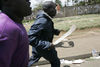 Supporters of the Orange Democratic Party run with machetes, Saturday, Dec. 29, 2007 during riots in the Kibera slum in Nairobi.
