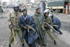 Police react as opposition supporters throw stones at them, Sunday, Jan. 20, 2008 during ethnic fighting in the Mathare slum in Nairobi.