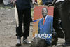 An opposition supporter hold a crude weapon next to a poster of their leader Raila Odinga, Sunday, Jan. 20, 2008 during ethnic fighting in the Mathare slum in Nairobi