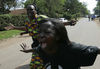 Woman cry outside the house of opposition lawmaker Mugabe who were gunned down,Tuesday, Jan. 29, 2008 in Nairobi