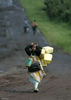 A young girl carry her belongings as she flee fighting, Sunday, Oct. 26, 2008 near Kibumba some 40 kilometers north of Goma in eastern Congo.