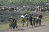 Thousands of displaced people stream into Goma in eastern Congo, Wednesday, Oct. 29, 2008.