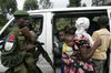 A Congolese goverment soldier force people out of a minibus as they check passengers at a checkpoint at the front line, Monday, Nov. 10, 2008 near Kibati just north of Goma in eastern Congo.