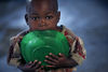 A displaced child chew on an empty plate in a abandoned church, Saturday, Nov. 15, 2008 in Kibati just north of Goma in eastern Congo.