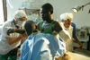 A Congolese man receive medical treatment at an Medecins Sans Frontieres hospital, Monday, June 2. 2003 after he lost his arm during an attack by tribal fighters three weeks ago in Bunia.