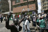 Opposition supporters hold machetes, Sunday, Jan. 20, 2008 during ethnic fighting in the Mathare slum in Nairobi.