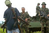 French soldiers and a Hema malitia fighter look at each other, Wednesday, June 11. 2003 on the outskirts of Bunia, Congo.