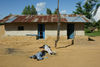 Two corpses lies in a deserted street in Bunia , Saturday, May 17. 2003 in the Congo.