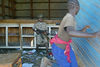 Chipe a ten year old Hema malitia chase a women out of a house by gunpoint in the market in Bunia, Sunday, May 18. 2003.