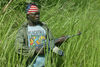 A Lendu militia fighter secure the perimiter of a Lendu camp just outside Bunia, Wednesday, May 21. 2003 in northeast Congo .