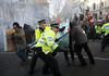Protesters and police officers clash during a protest against an increase in tuition fees on the edge of Parliament Square in London, Thursday, Dec. 9, 2010.  Police clashed with protesters marching to London's Parliament Square as lawmakers debated a controversial plan to triple university tuition fees in England.(