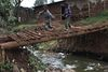 Children run across a stream of raw sewage on a makeshift bridge,Wednesday, May 27, 2009 in the Kibera slum in Nairobi, Kenya.Kibera in Nairobi, Kenya is the largest slum in Africa, and has a population estimated at one million.