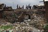 People cross a bridge over a stream of raw sewage,Wednesday, May 27, 2009 in the Kibera slum in Nairobi, Kenya.Kibera in Nairobi, Kenya is the largest slum in Africa, and has a population estimated at one million.