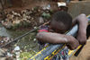 A girl play on a bridge spanning a stream of raw sewage ,Wednesday, May 27, 2009 in the Kibera slum in Nairobi, Kenya.Kibera in Nairobi, Kenya is the largest slum in Africa, and has a population estimated at one million.