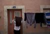 A woman do her laundry , Saturday, April 9, 2011 in downtown Lisbon, Portugal. (AP Photo/Karel Prinsloo)
