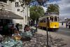 People enjoy lunch at a cafe, Saturday, April 9, 2011 in downtown Lisbon, Portugal. (AP Photo/Karel Prinsloo)