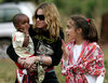 Madonna hold David Banda in her arms as her daughter Lourdes interact with David, Tuesday, April 17, 2007 at the Home of Hope orphanage in Mchinji, Malawi .