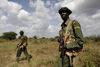 Kenya Wildlife Rangers patrol looking for poachers in the Tsavo East national park, Tuesday, March 9, 2010 in Kenya.