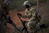 Kenya Wildlife Ranger Sgt. Benson Munga from the anti poaching unit look for tracks at the fence separating the Tsavo East game park from ranches in Kenya 5 June 2013. PHOTO/KAREL PRINSLOO