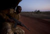 Kenya Wildlife Range Gafo Enos from the anti poaching unit during a patrol on the back of a truck in the Tsavo East game park in Kenya 8 June 2013. PHOTO/KAREL PRINSLOO
