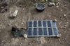 A solar panel charge radio batteries at a Kenya Wildlife Ranger observation point in the Tsavo East game park in Kenya 5 June 2013. PHOTO/KAREL PRINSLOO