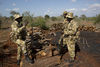 Kenya Wildlife Rangers after they discovered an illegal charcoal burning sight in the Tsavo East game park in Kenya 6 June 2013. PHOTO/KAREL PRINSLOO