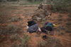 Exhausted Kenyan Somali herders sleep as they move their cattle just outside the Tsavo East game park in Kenya 9 June 2013. PHOTO/KAREL PRINSLOO