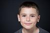 cute boy with dimples in portrait session at Modiin photography studio