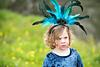 girl dressed up as peacock in outdoor portrait