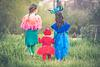 three kids in costume outdoors