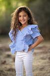 cute girl in blue and white fashion posing outdoors  in Jerusalem