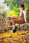 fashion model at Ein Kerem in autumn with golden brown leaves