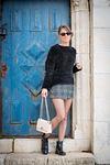 fashion model at Ein Kerem next to blue door