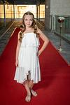 Bat Mitzvah girl posing on red carpet before her party