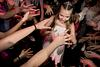 Bat Mitzvah girl dancing in circle with all her friends around her