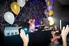 Bat Mitzvah girl playing music with the dj at her party
