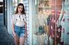 Bat Mitzvah girl next to fashion boutique window Tel Aviv