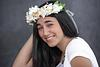 Bat Mitzvah girl in white shirt and flower Bouquet in front of canvas backdrop Photography studio Modiin
